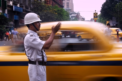 A constable traffic policeman directing taxis Calcutta Kolkata I
